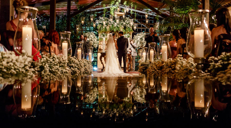 Couple in the alter surrounded by wonderful wedding decoration
