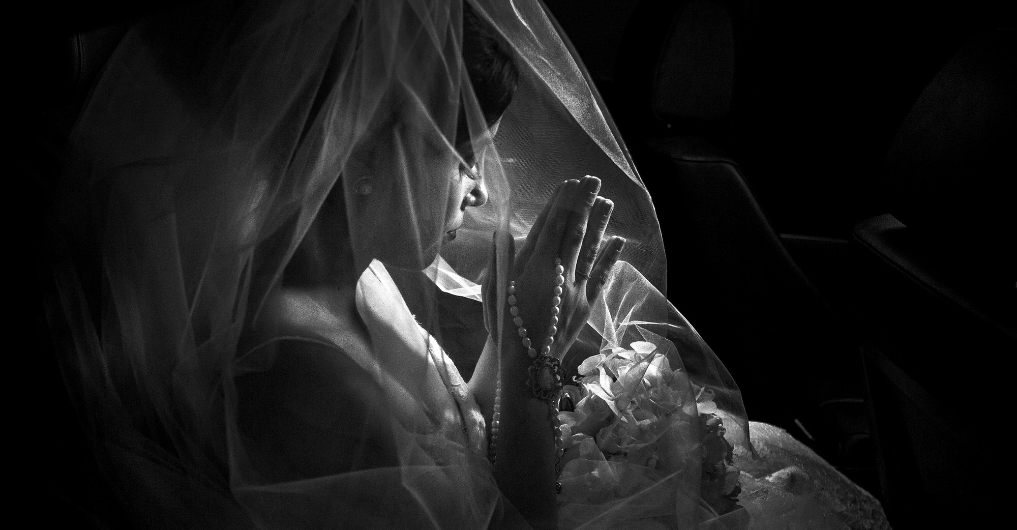 Bride praying before the ceremony